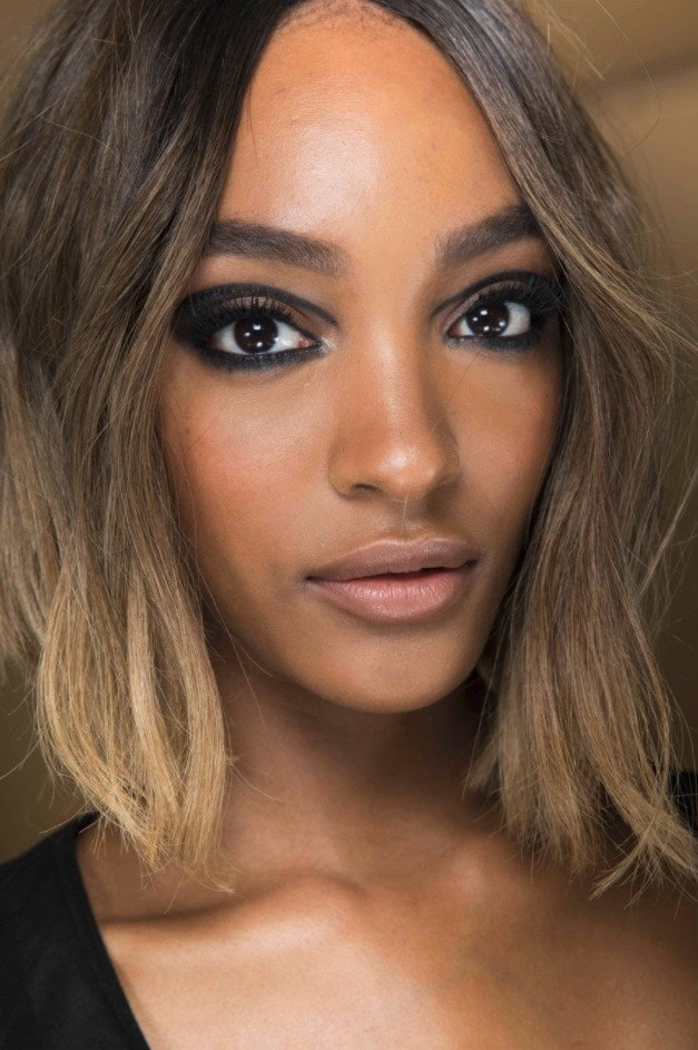 Brown hair with blonde highlights: Close-up backstage picture of Jourdan Dunn with a light brunette a line bob with ash blonde highlights