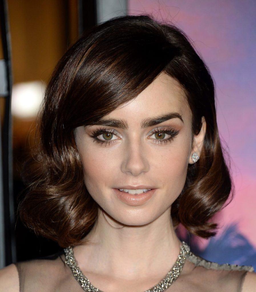 short bob hairstyles: lily collins with short wavy bob hair