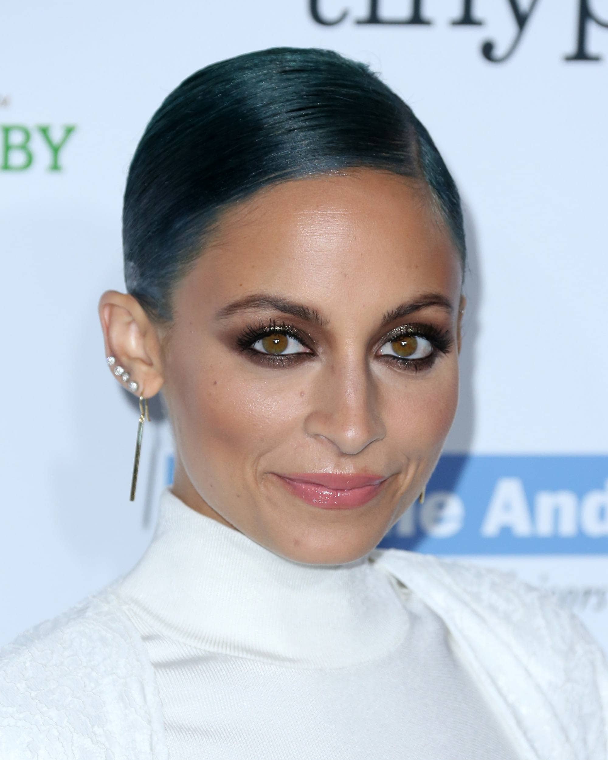 Blue hair: Nicole Richie with dyed blue hair in a sleek wet-look combover updo