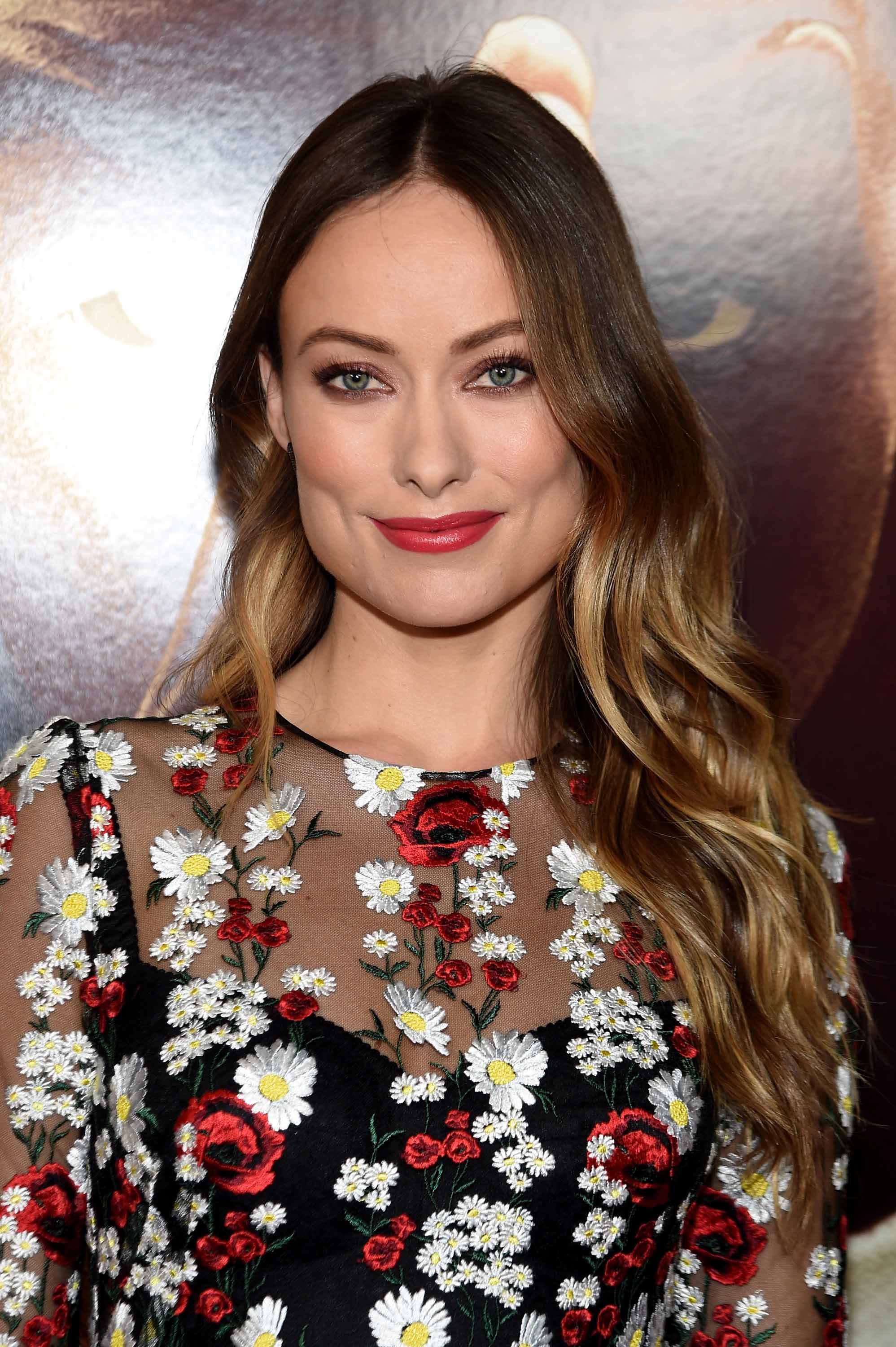 Brown hair with highlights: Olivia Wilde with subtle blonde highlights on brown hair wearing a floral dress