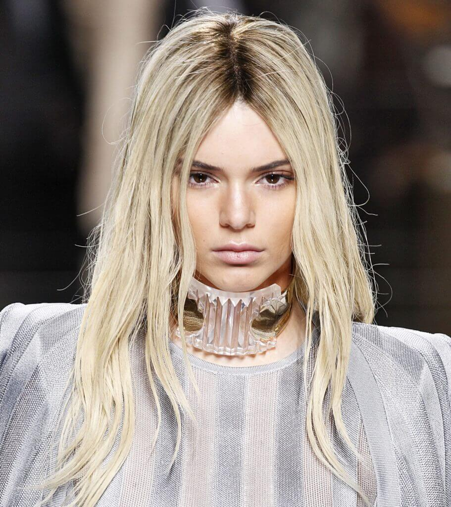 front facing image of a woman at the Balmain SS16 catwalk show with platinum blonde hair