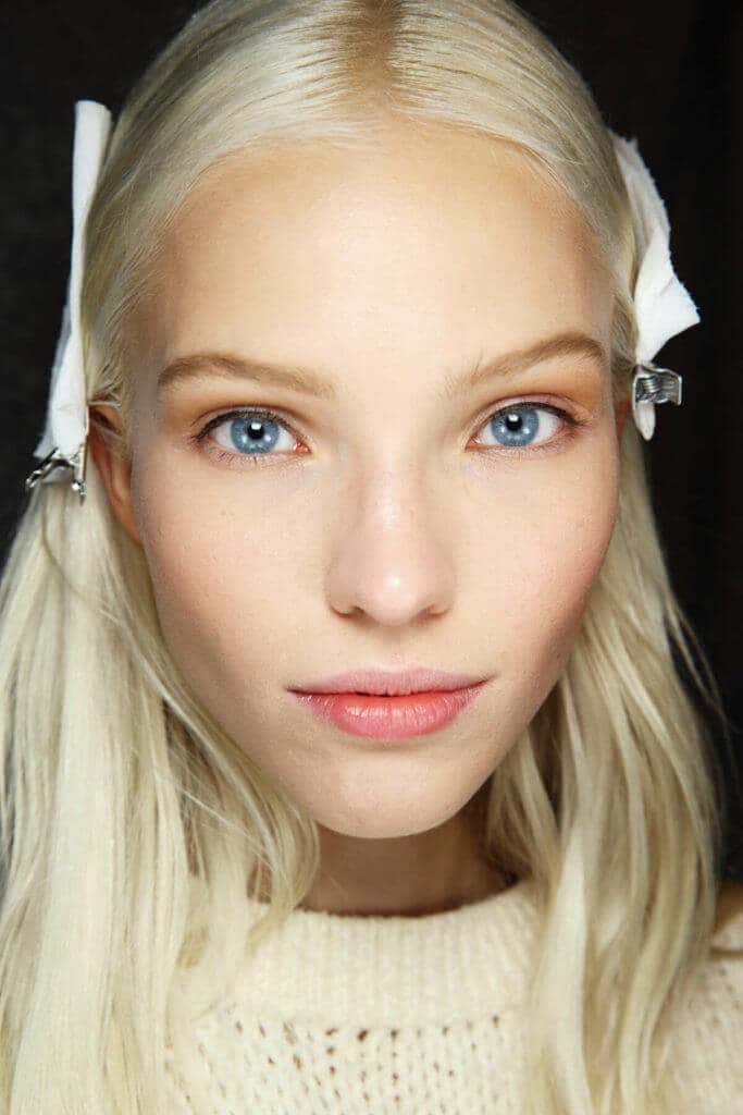 front facing image of a model with platinum blonde hair colour