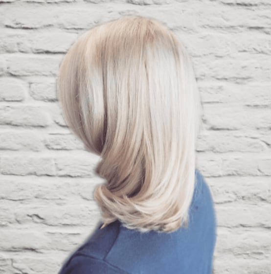 side view of a woman's hair with smooth and sleek platinum blonde hair