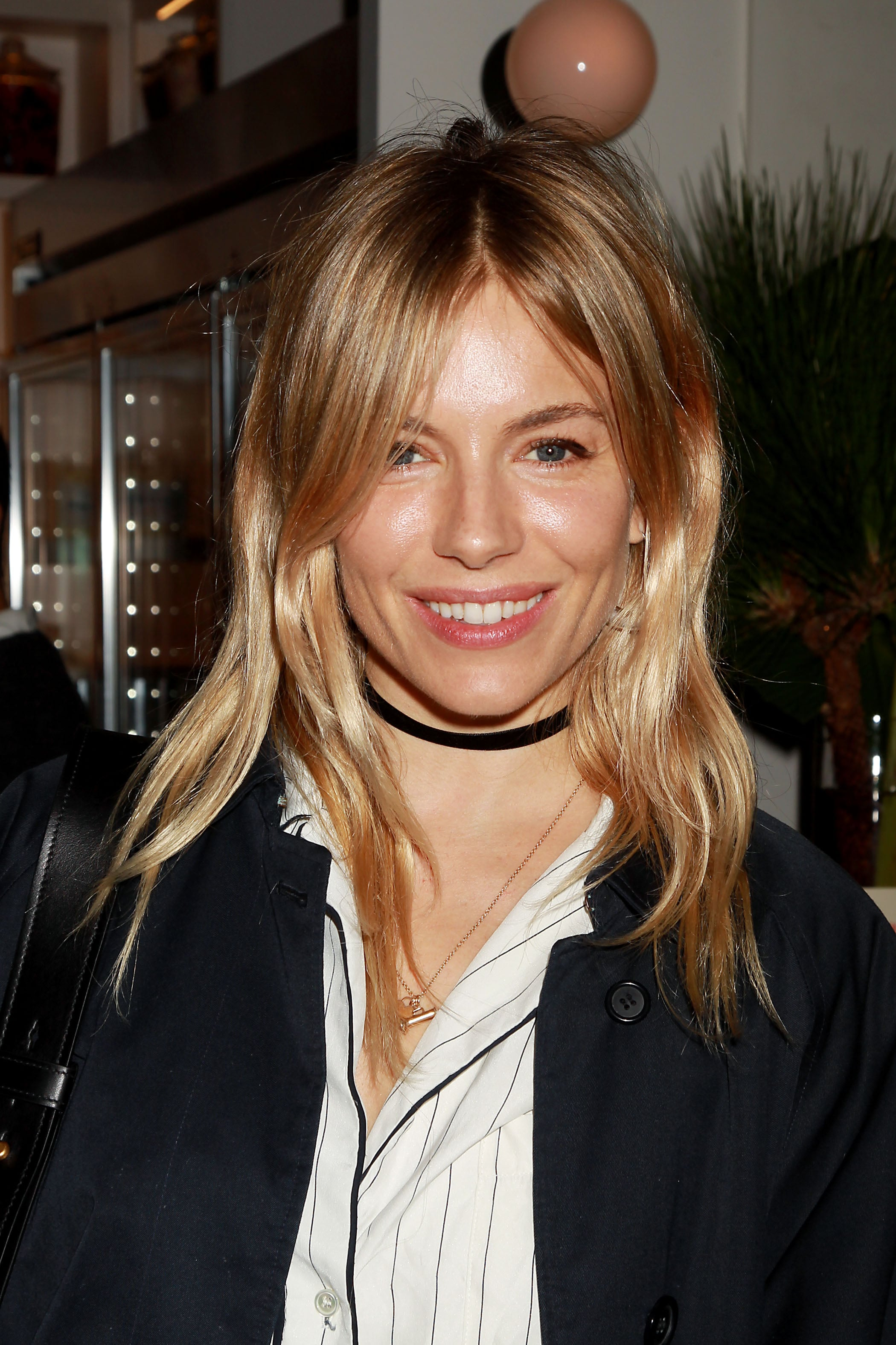 Dirty blonde - Sienna Miller with mid length straight hair and grown out bangs