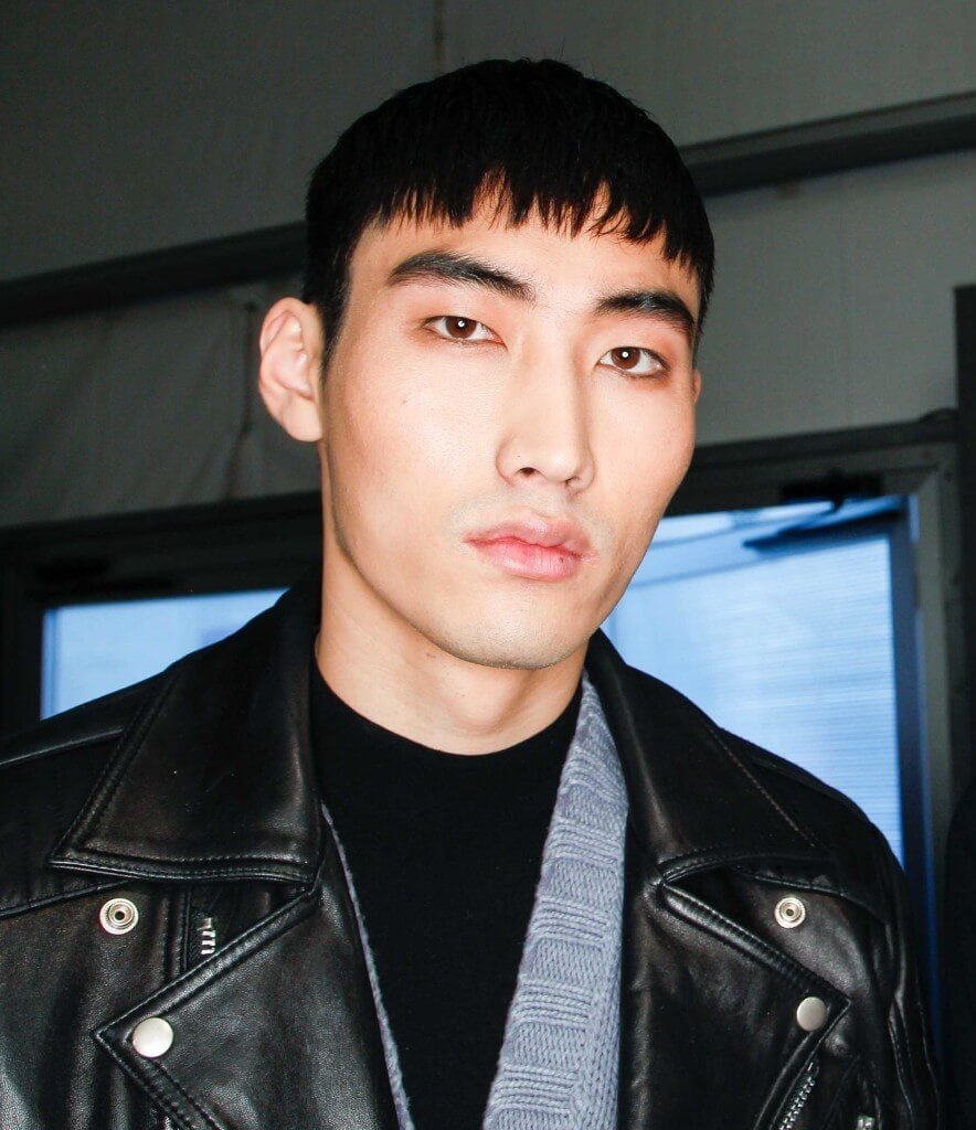 front view image of man with short black hair and a French crop hairstyle