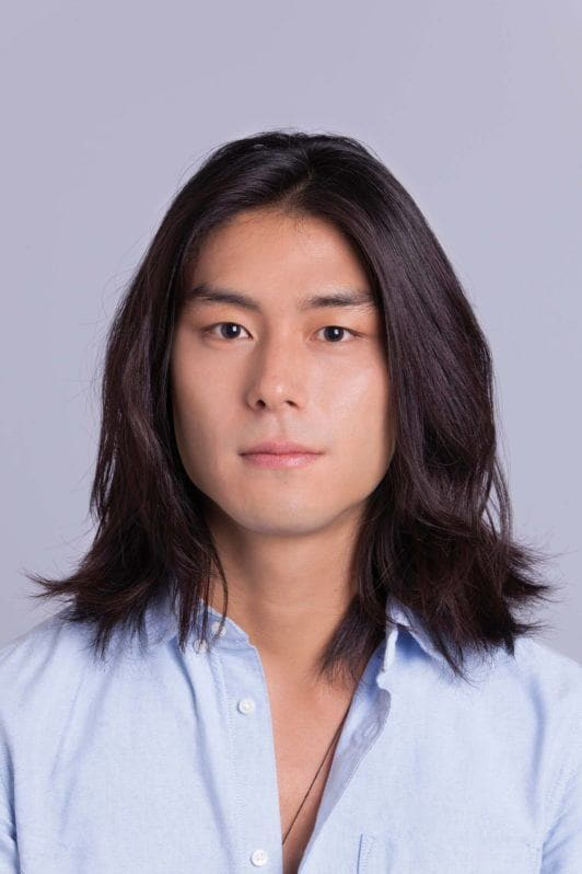 Asian man bun: Asian male model with shoulder-length hair down