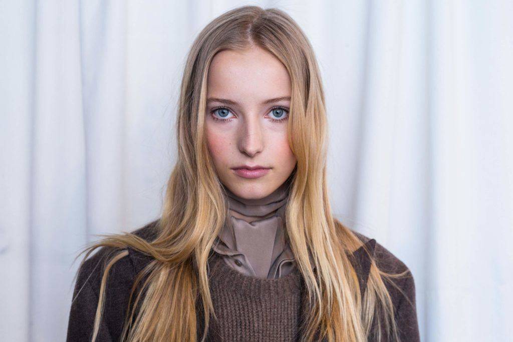 image of a woman with very long dark blonde hair worn down