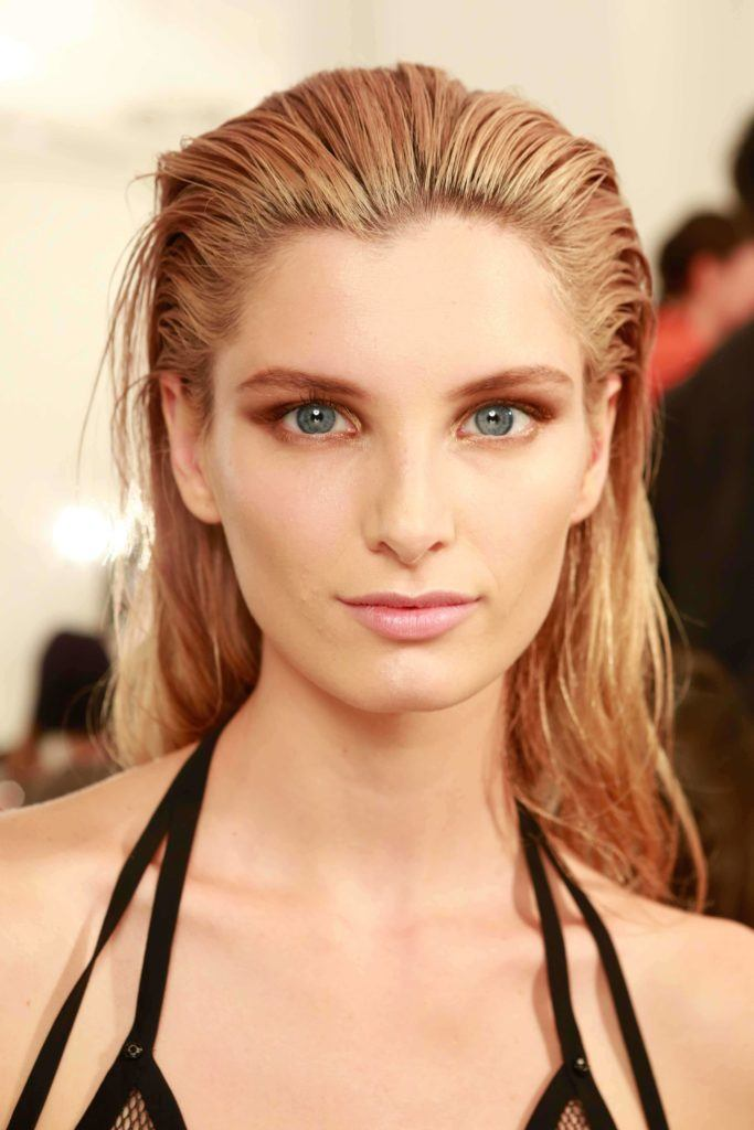 image of a woman with hair swept back worn long with a dark blonde colour