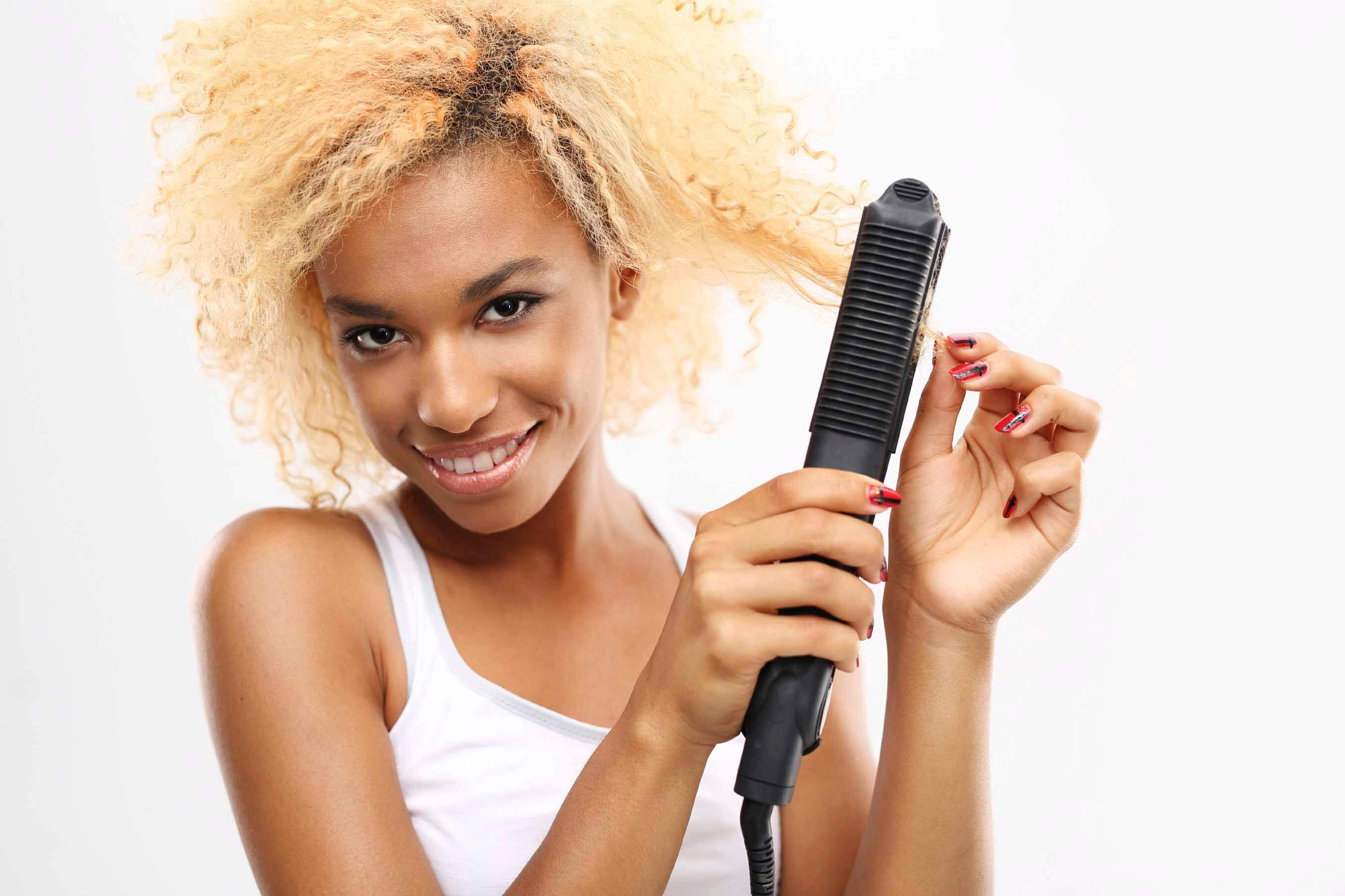 Blonde afro hair with straightener