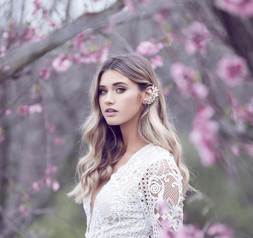 Bridal hair ideas blonde with loose boho waves and embellished ear cuff