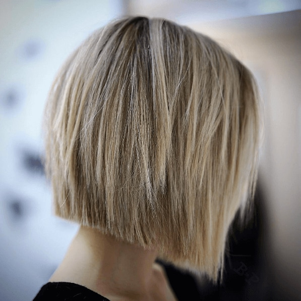 side view of a woman's hair with choppy blonde bob