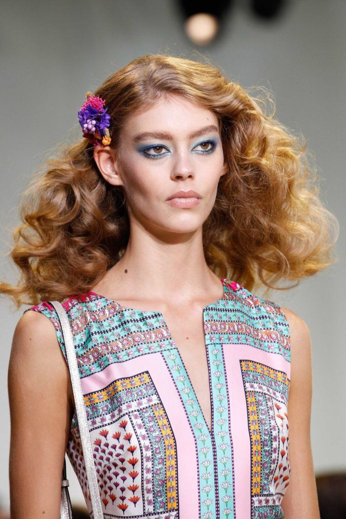 curly red hair female fashion model on the runway