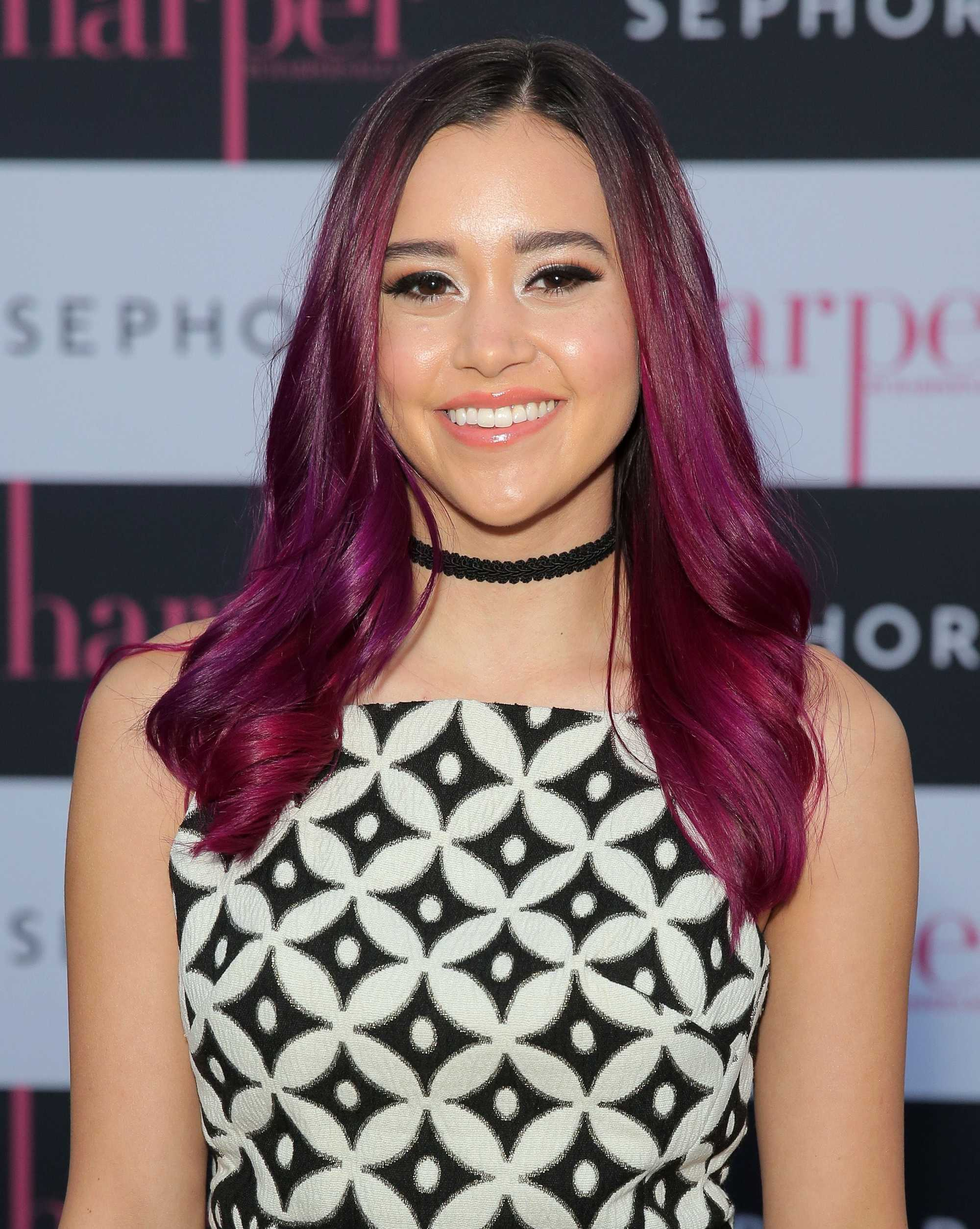 megan nicole with dark purple hair on the red carpet