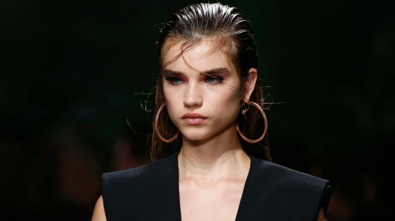 Model on the Versace SS20 runway with slicked back gelled hair