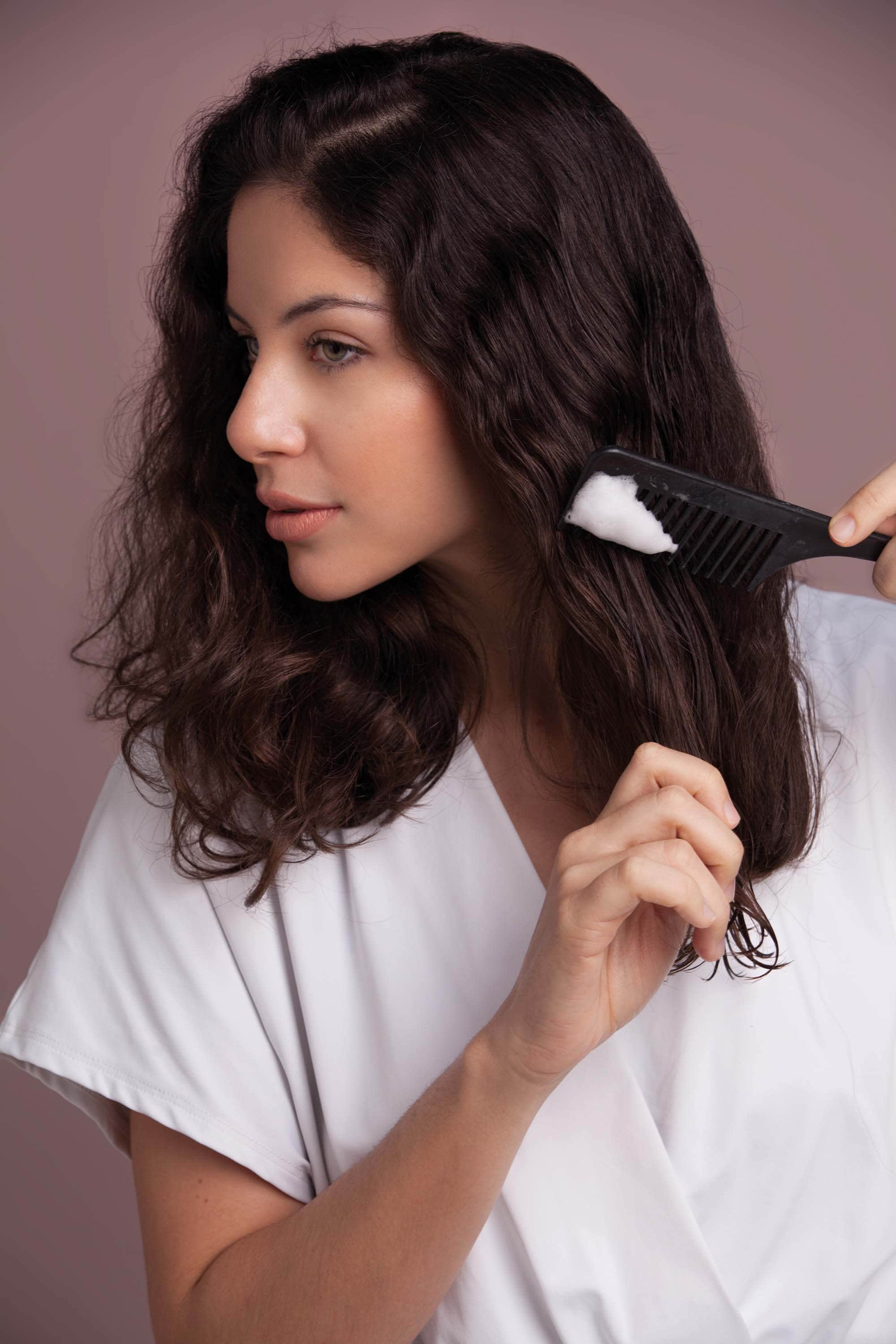hair mousse can be applied onto a comb