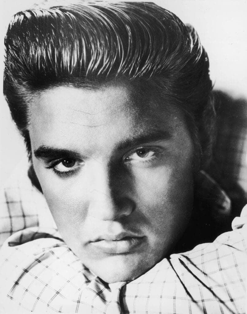 black and white image of Elvis Presley with a big quiff