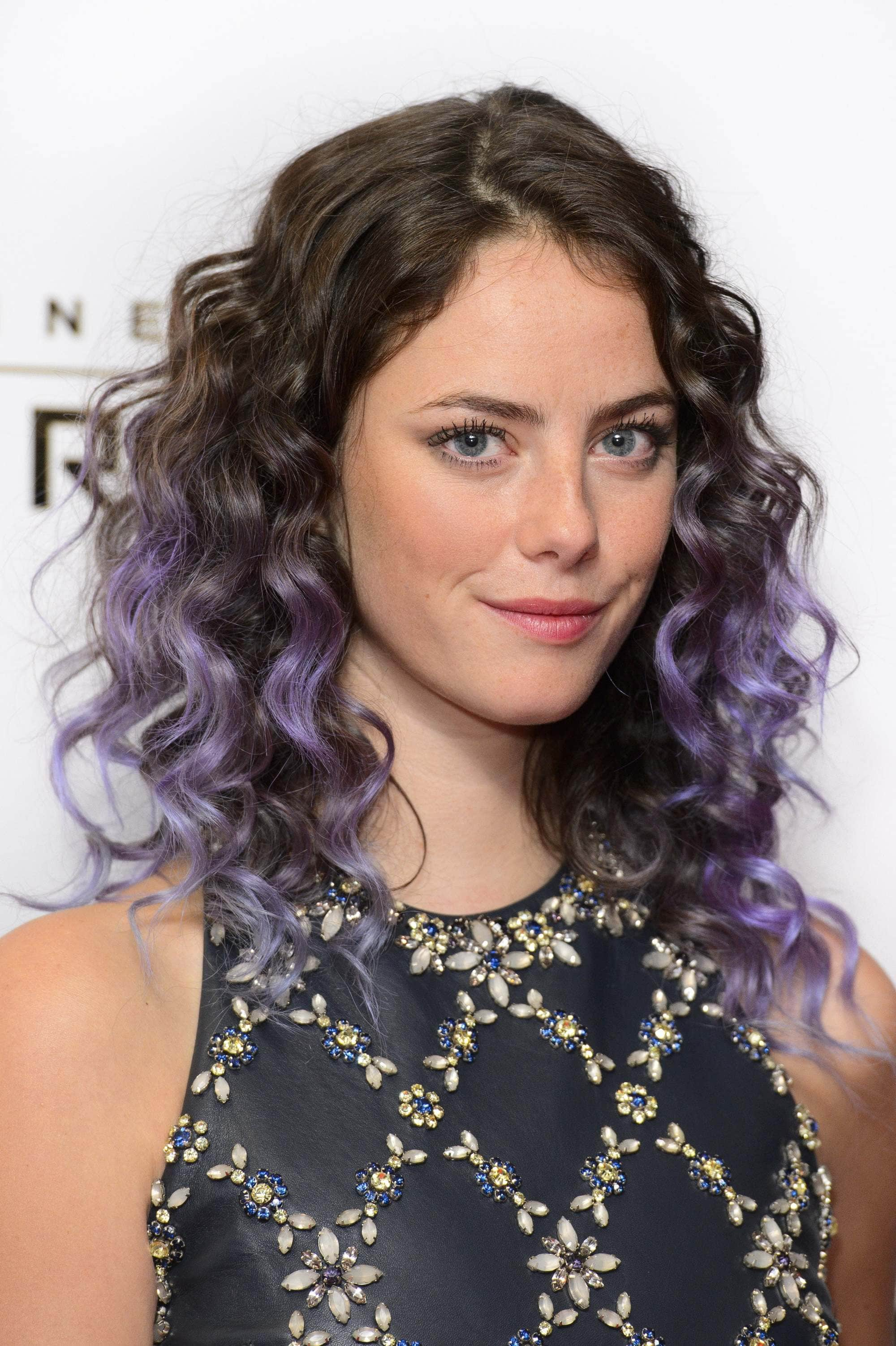 kaya scoldelario with dark hair and purple ombre hair