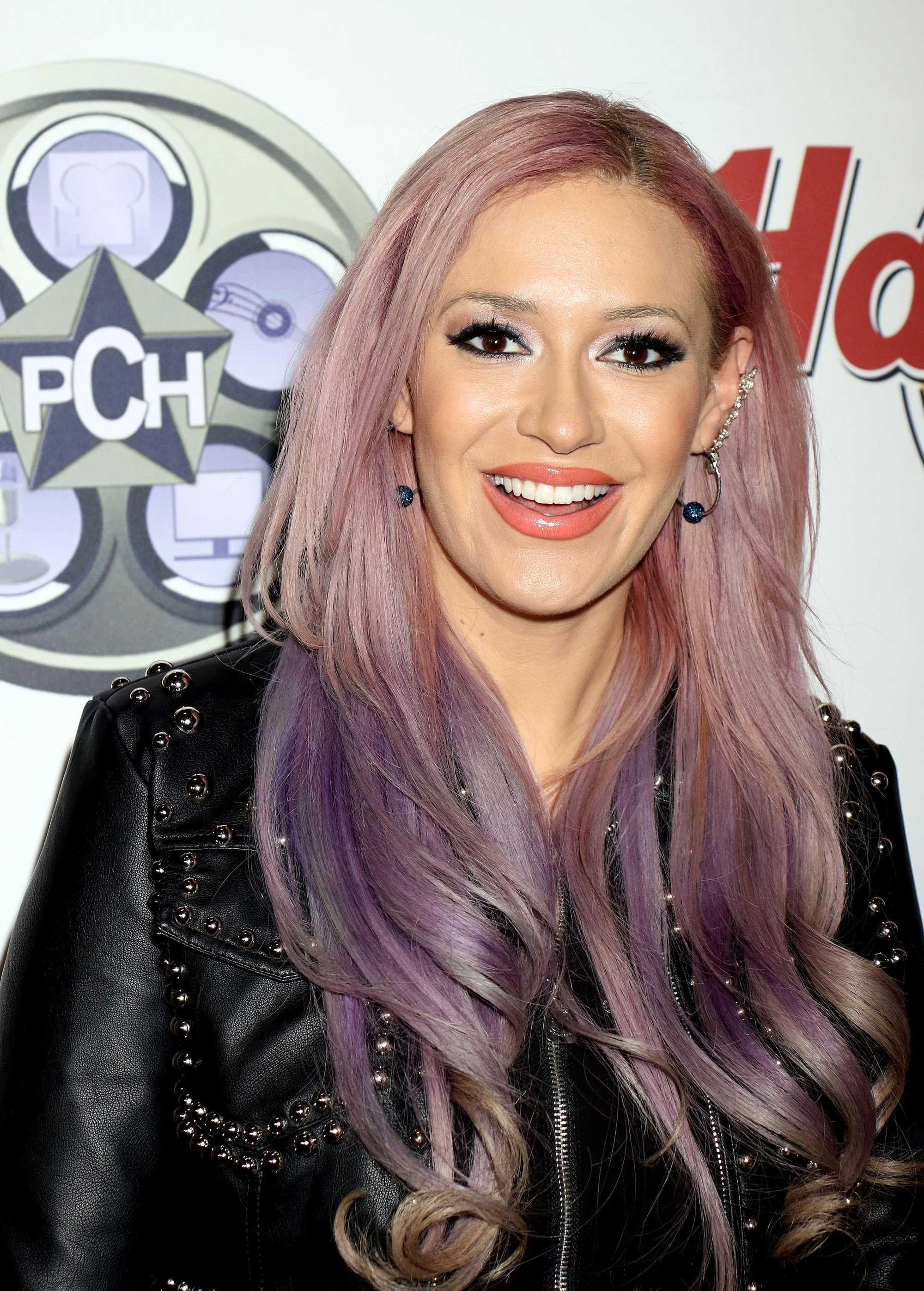 kayah jones with long purple hair on the red carpet