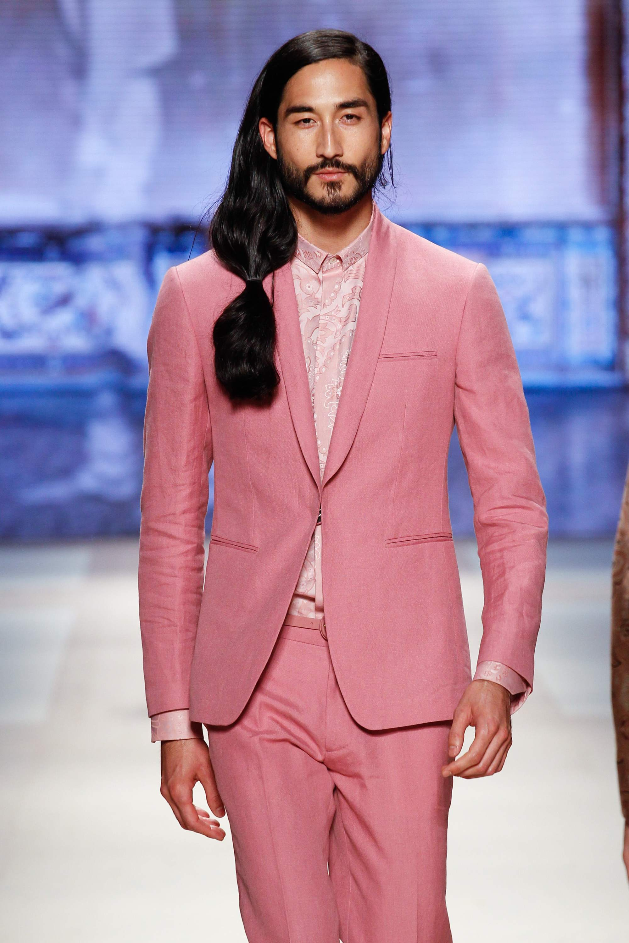 Asian men hairstyles: A young Asian man with long straight hair in a ponytail at Etro SS16 catwalk