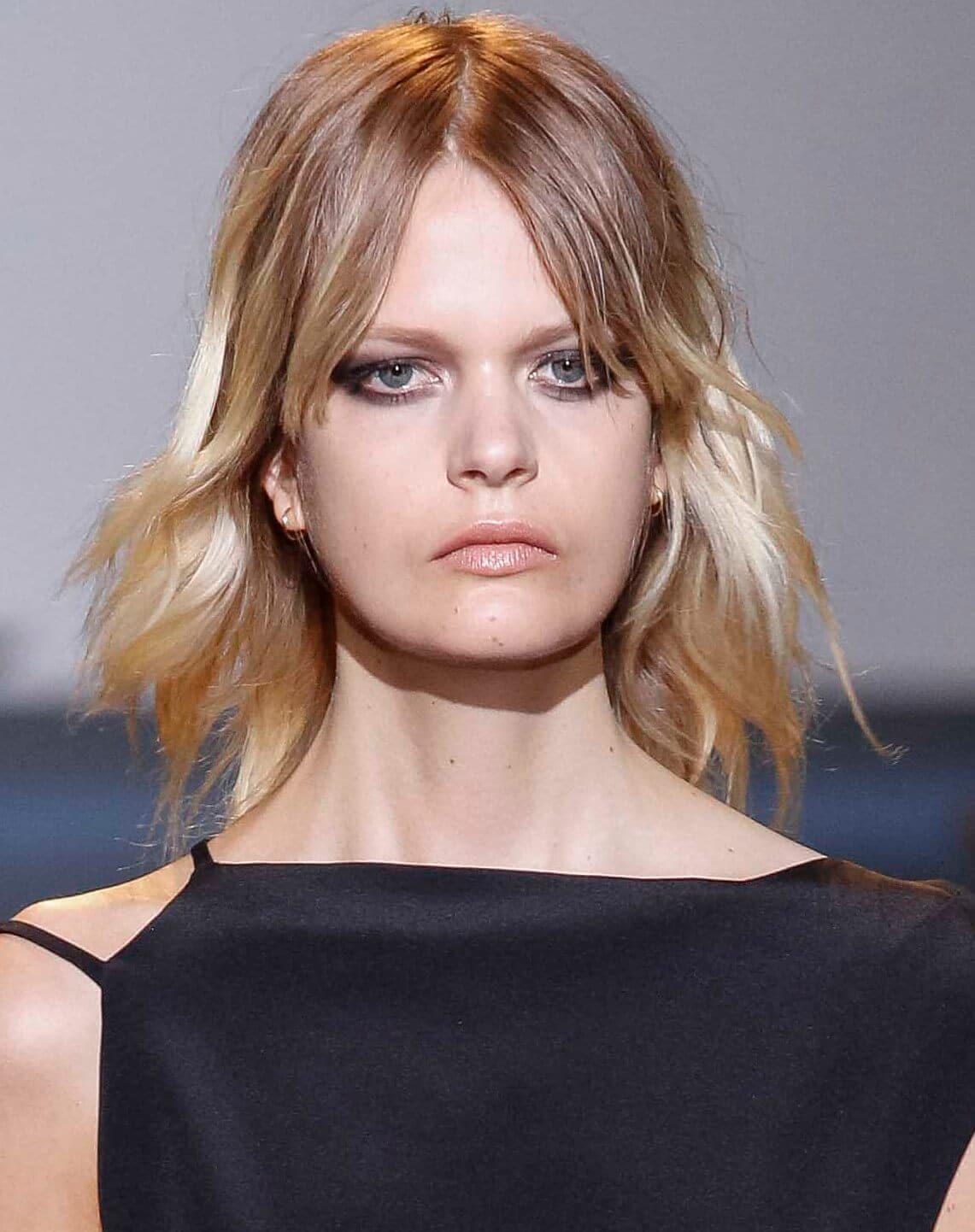 blonde short layers with fringe modern mullet