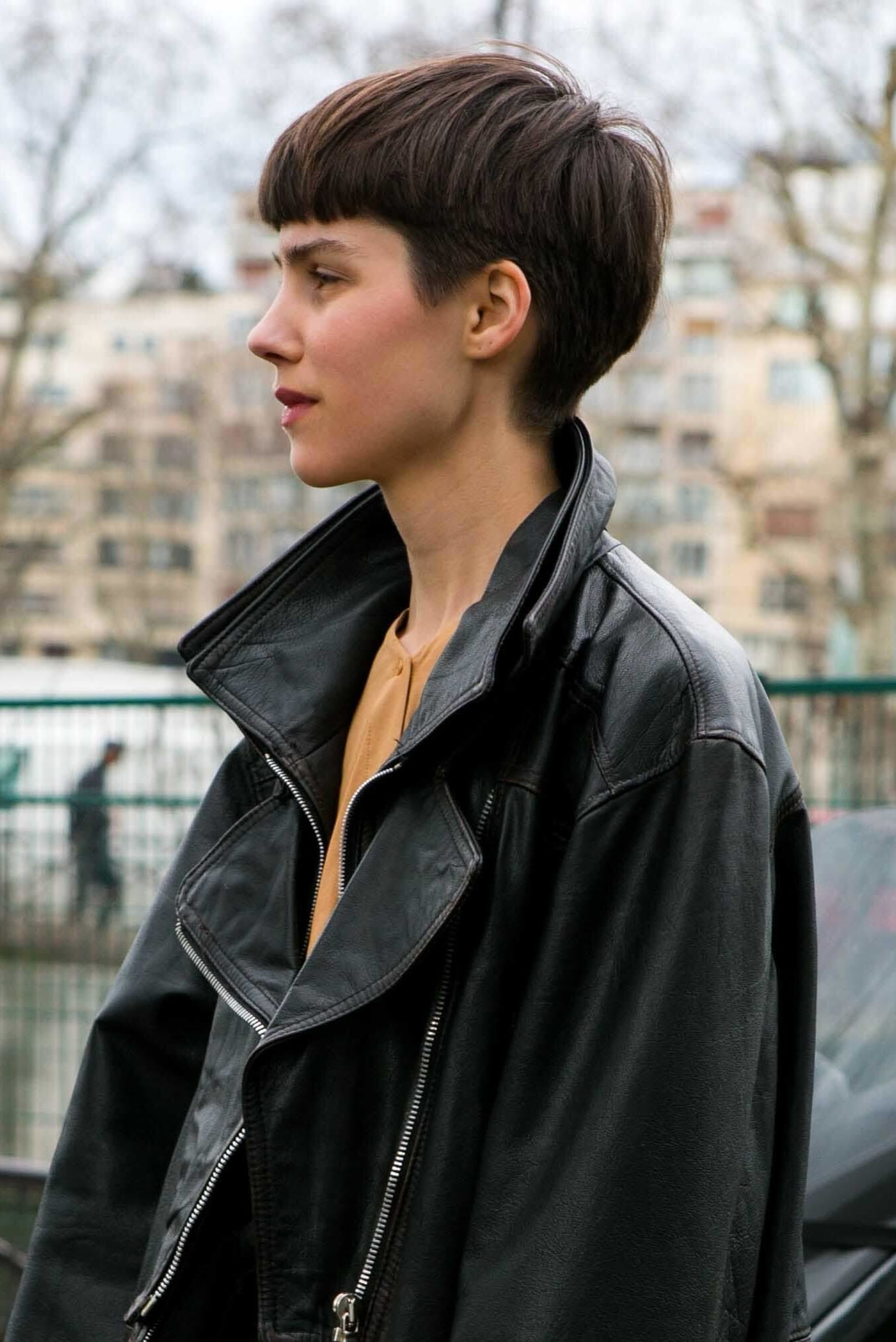 Would I suit short hair? Should I cut my long hair? Brunette with bowl short haircut wearing a biker jacket