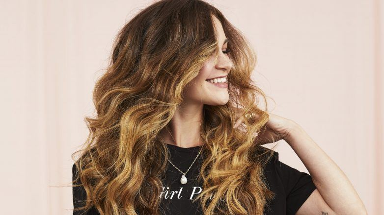 Woman with full, bouncy hair smiling