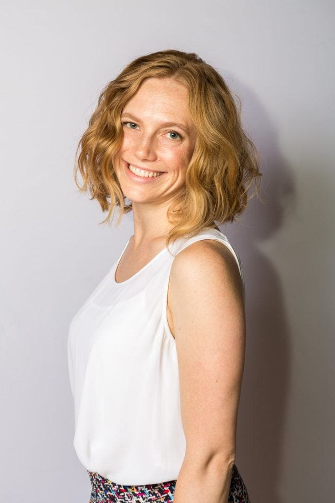 front view image of a woman with honey blonde hair and strawberry blonde hair colour