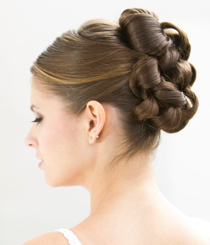 Brown haired bride with a curly wedding updo