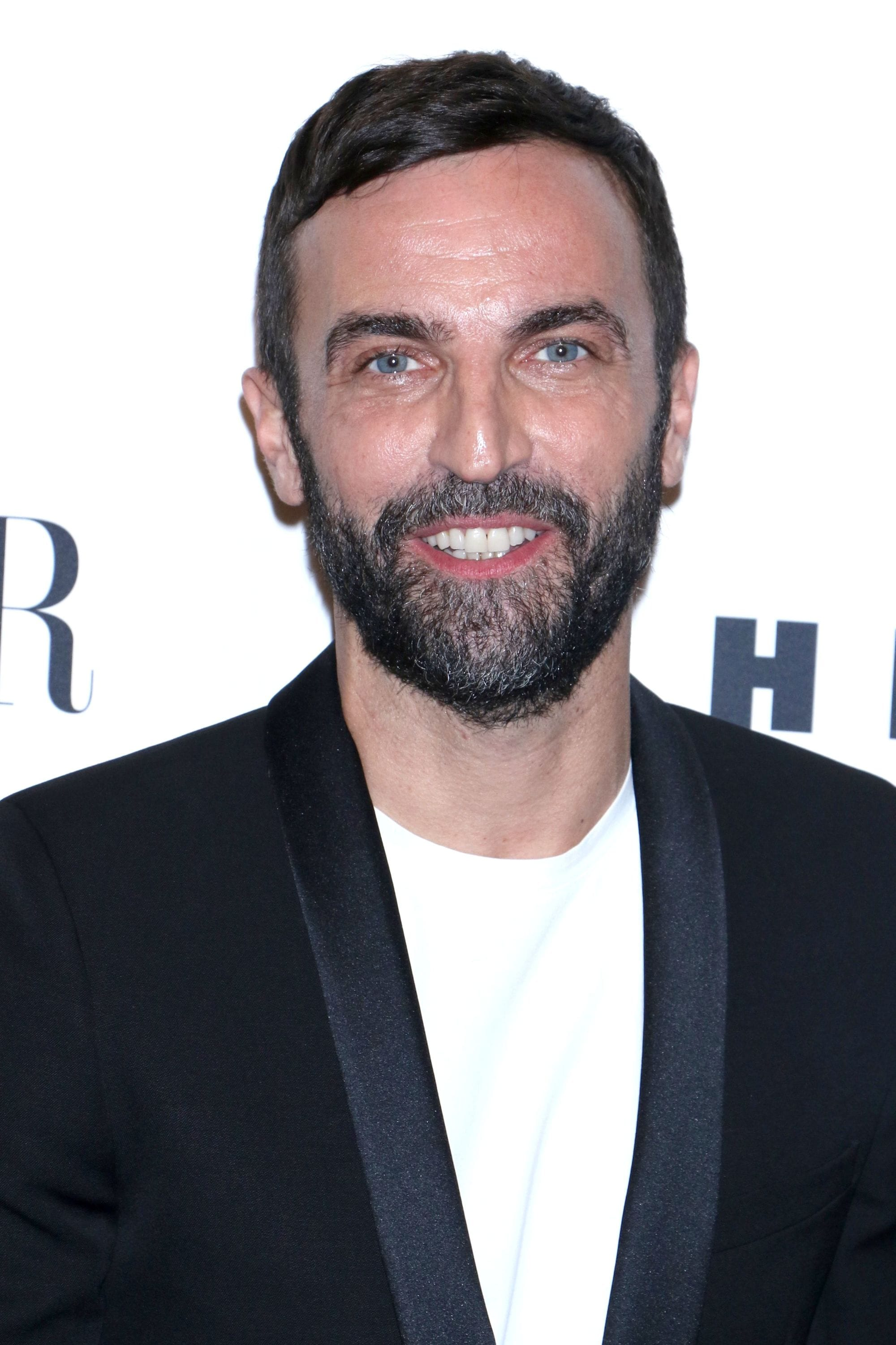 Hairstyles for men with thin hair: Nicolas Ghesquiere with short dark hair and a comb