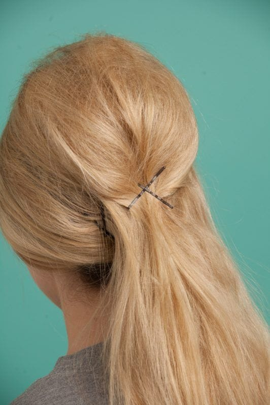 a blonde woman with her hair clipped on the backside