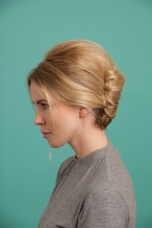 a side view of a french twist woman