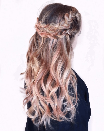 back shot of a woman with a blonde balayage crown braid with wavy pink ombre hairstyle