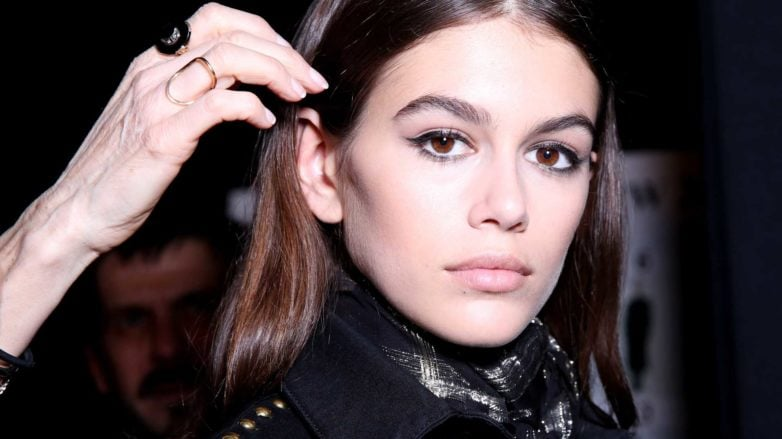Kaia Gerber backstage image medium length brown straight hair been styled