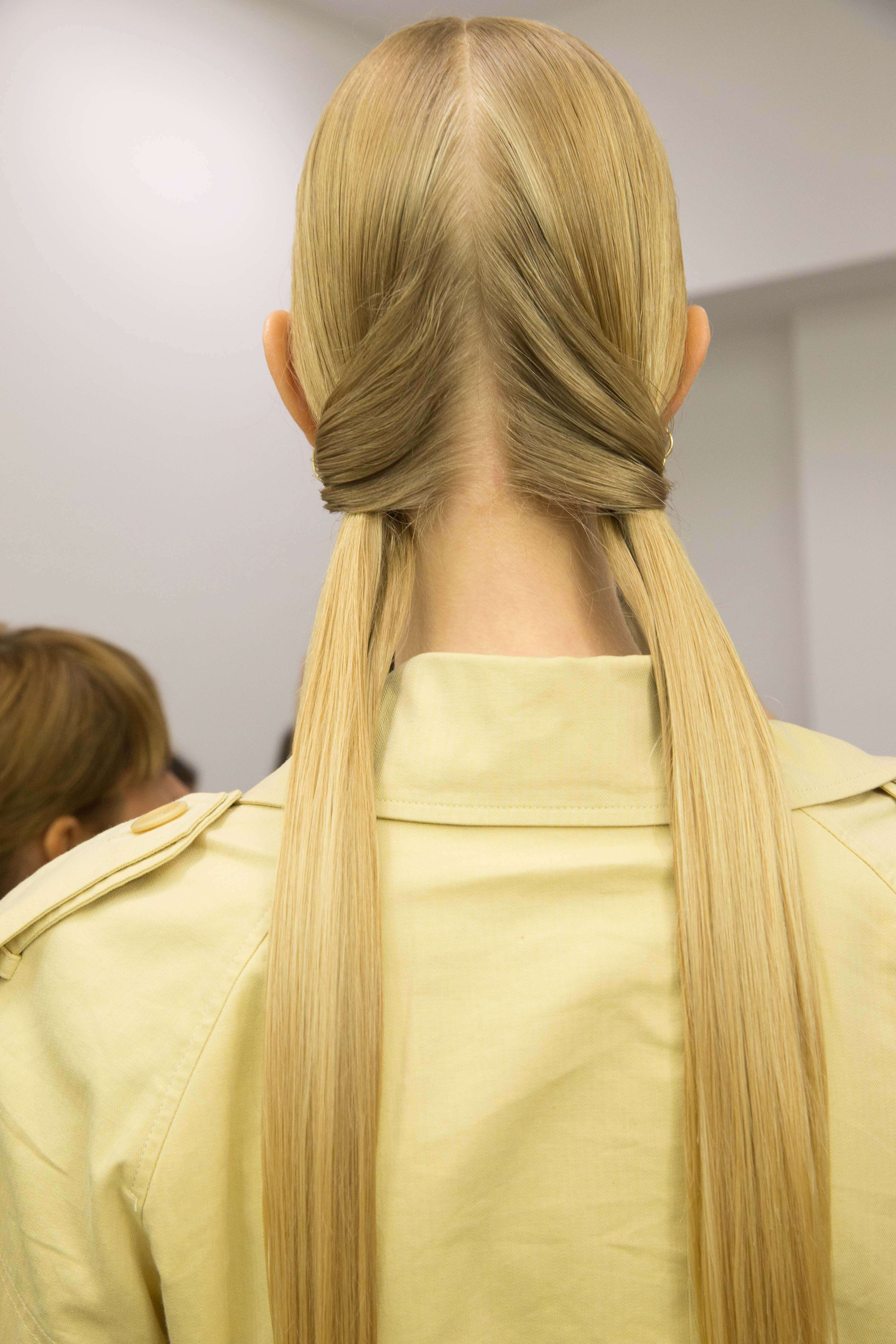 model with blonde hair wearing two straight pigtails