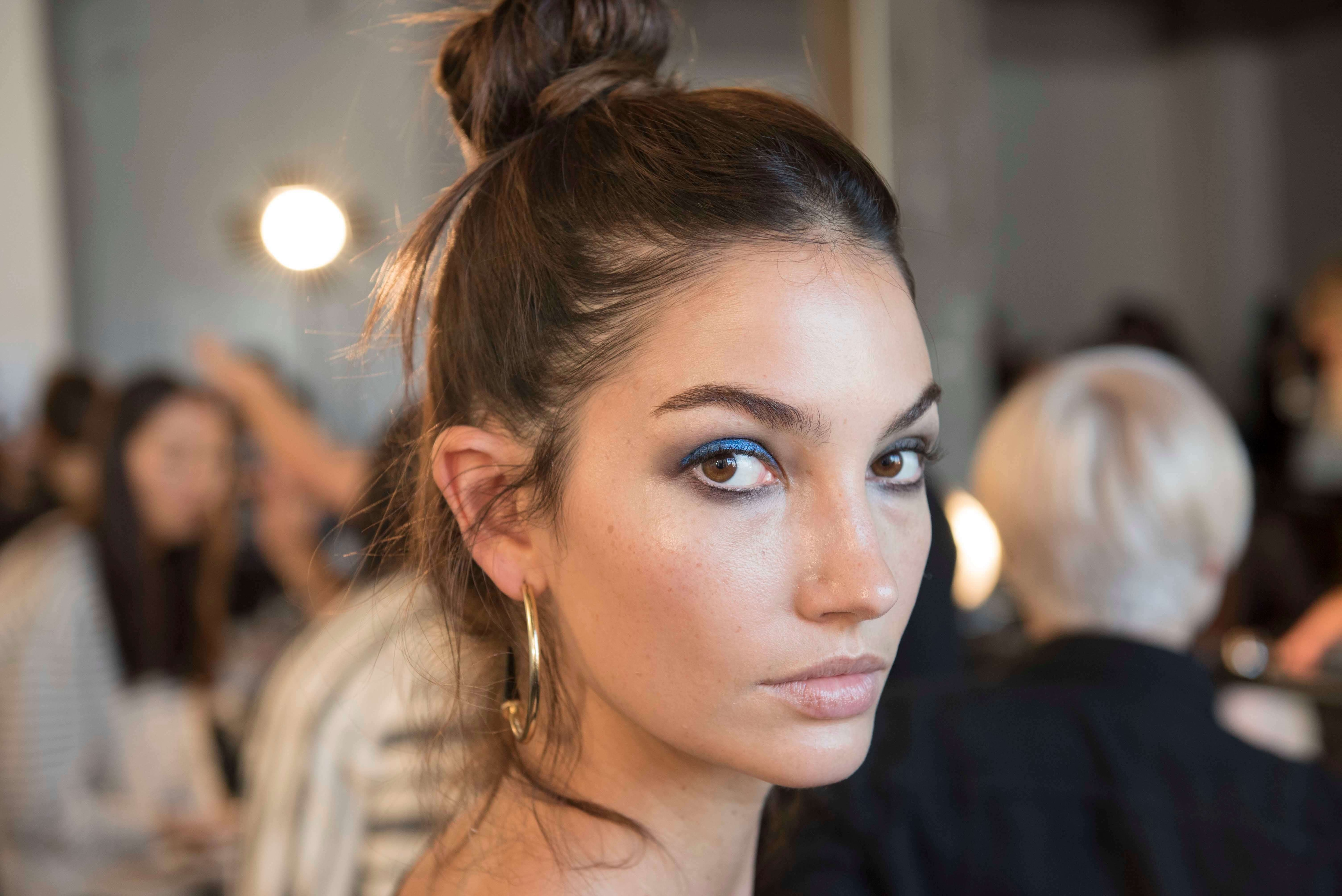hairstyles for straight hair high bun with loose brown hair