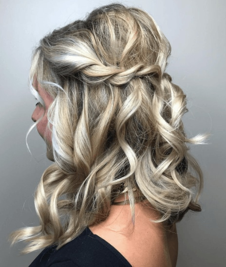 side view image of a womans hair with a braid and worn long and wavy - golden blonde hair
