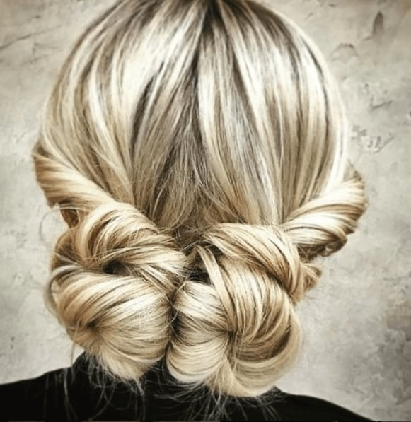 back view of a woman's hair with low space buns - golden hair