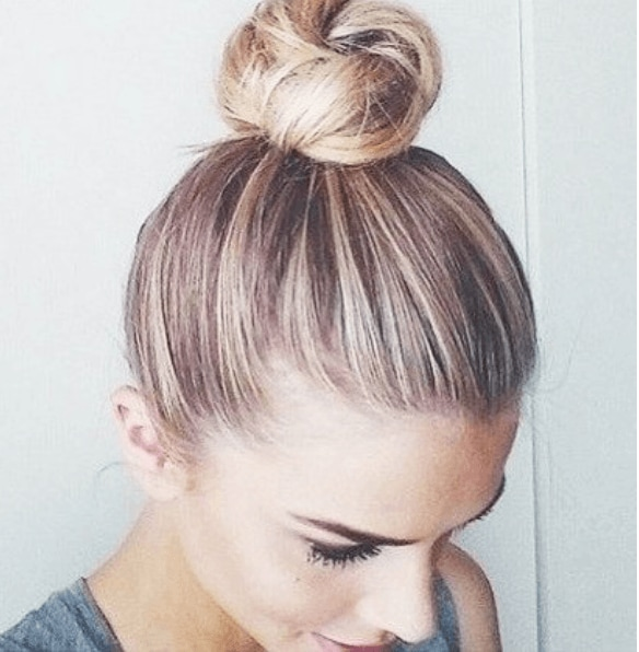 top view of a woman's golden hair in a top knot