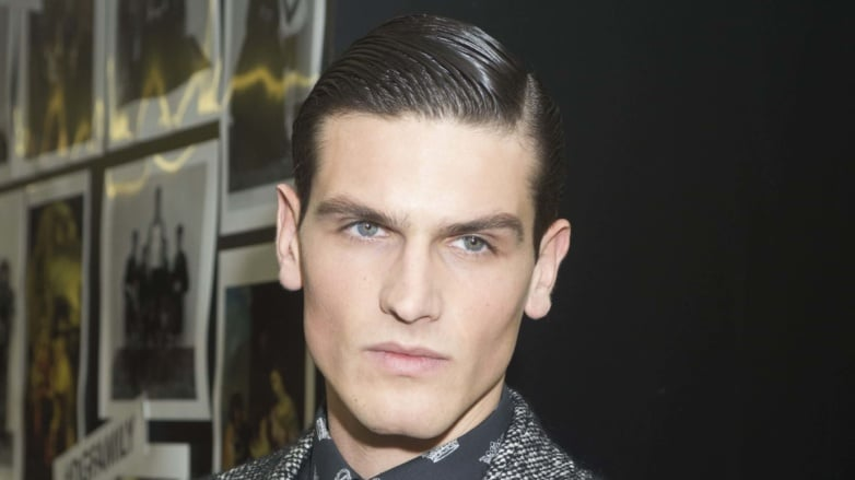 Dark haired man with groomed side parting hairstyle