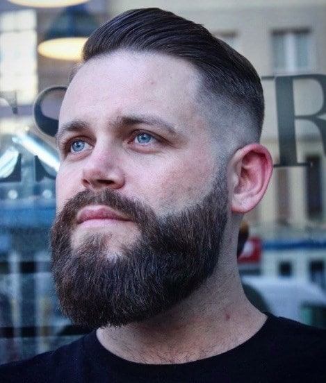 Hairstyles for men with thin hair: Man with a beard mustache and undercut brown hair