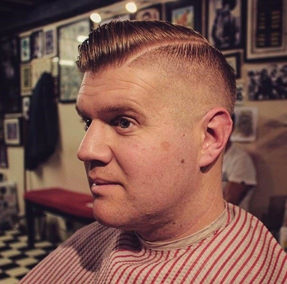Hairstyles for men with thin hair: Man with shaved sides and quiff hairstyle.