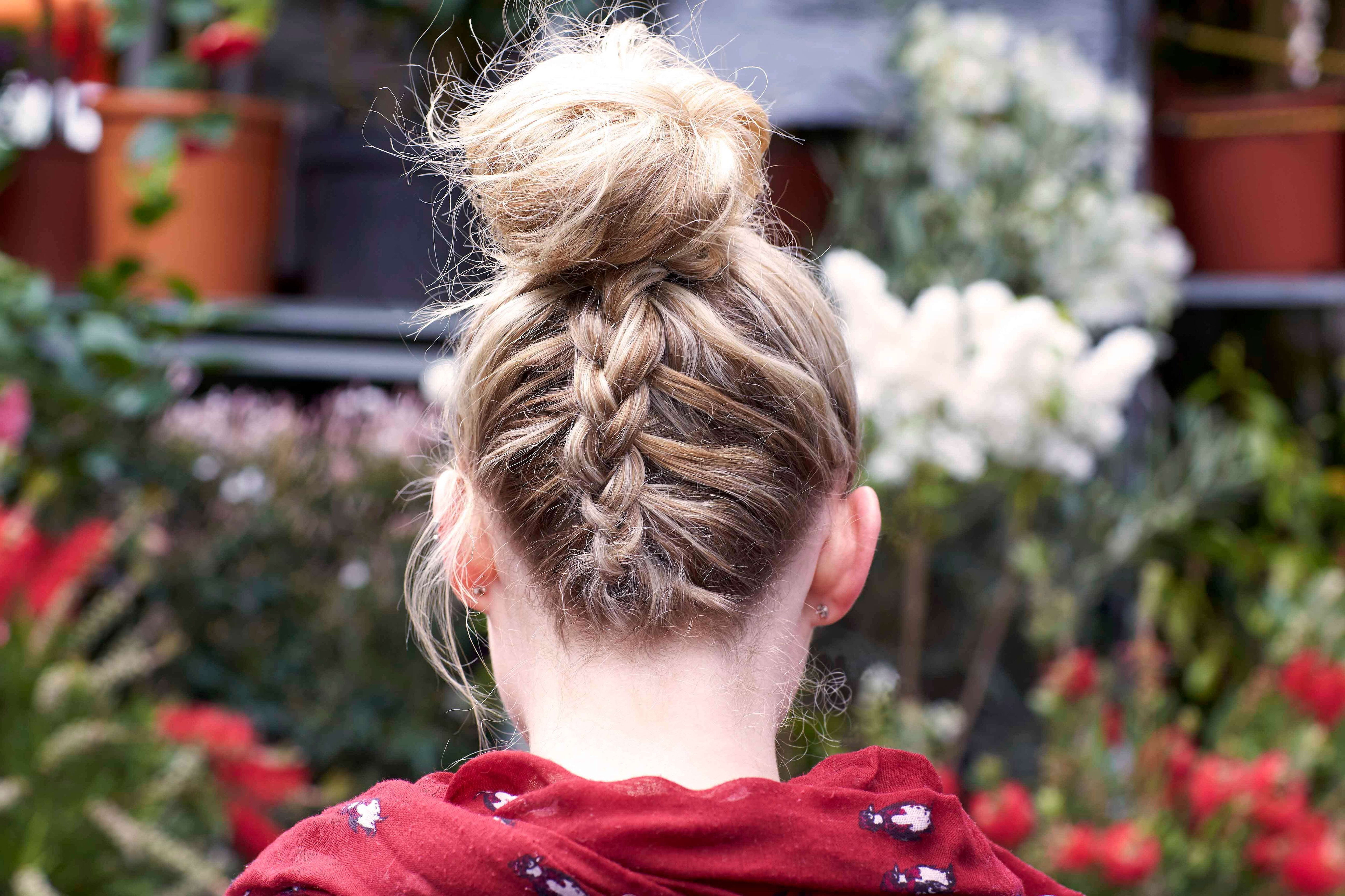 back view of model with blonde bun with French braided back