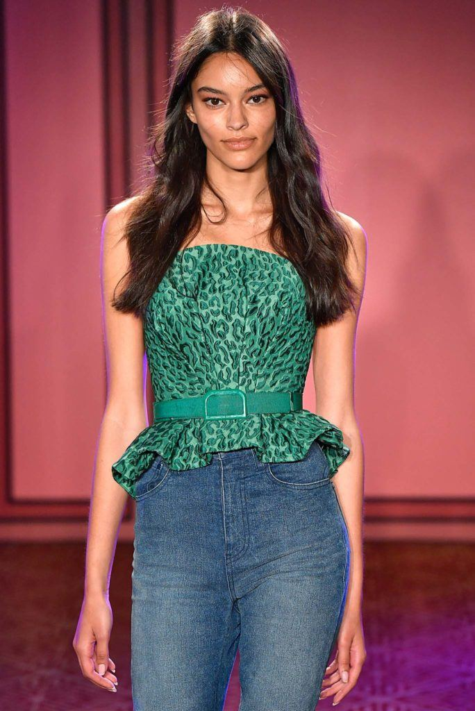 summer hairstyles for long hair: model on catwalk with long brown beach waves