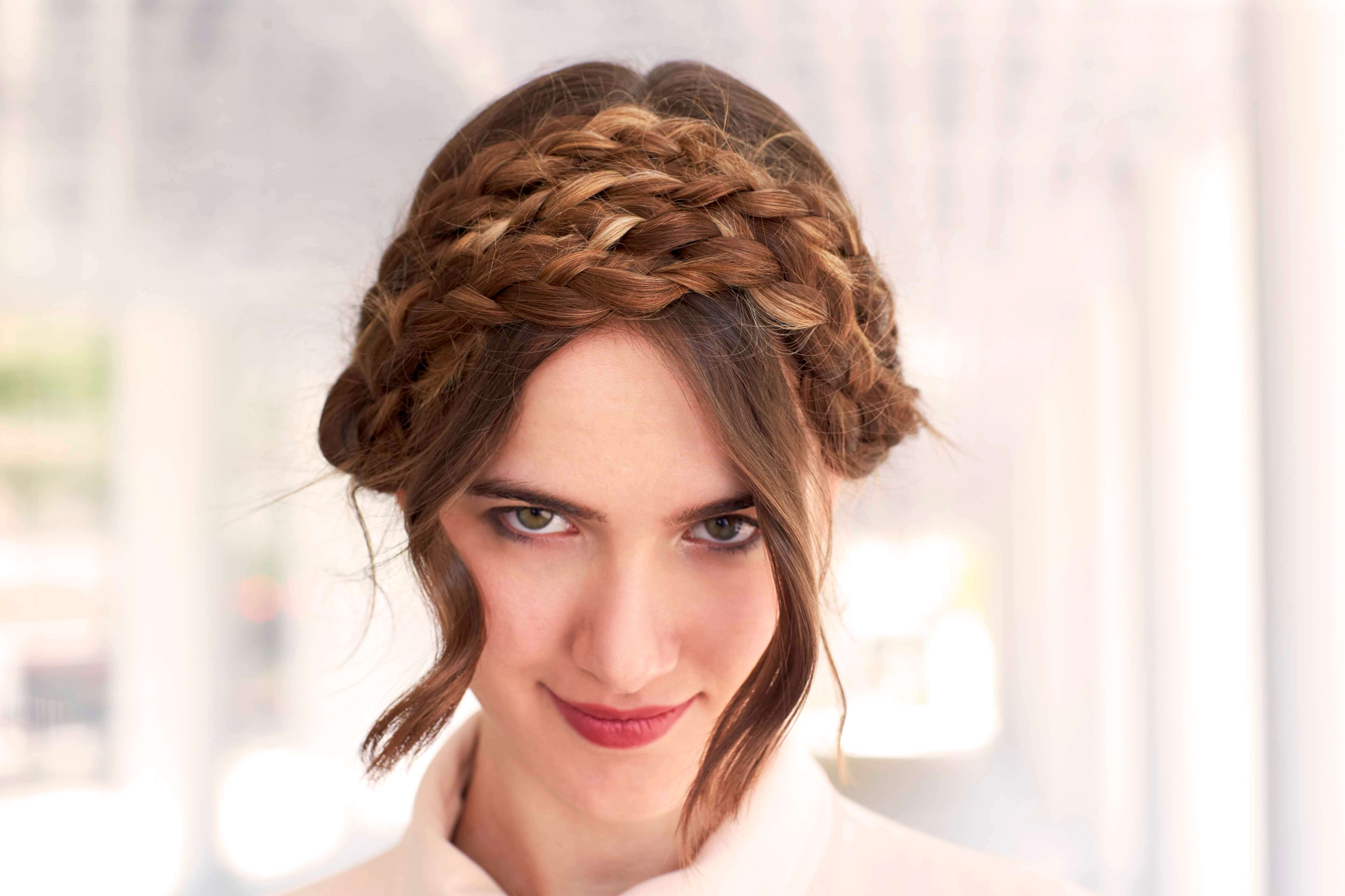 easy braiding hairstyles: young medium brown haired girl with simple double milkmaid braid