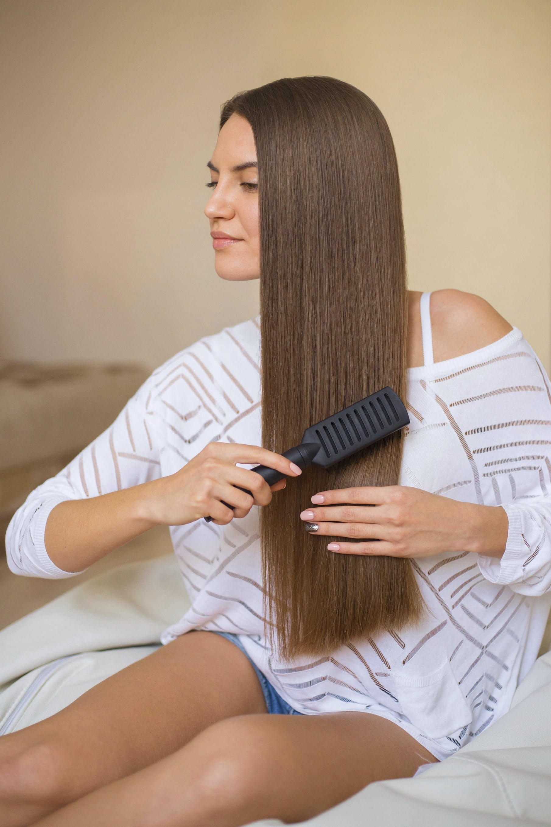 healthy smooth hair being brushed