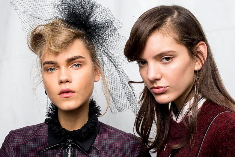 models from the Isabel Marant aw16 show with the left model wearing a black hairnet in her blonde hair and the right model with her brown worn down in waves