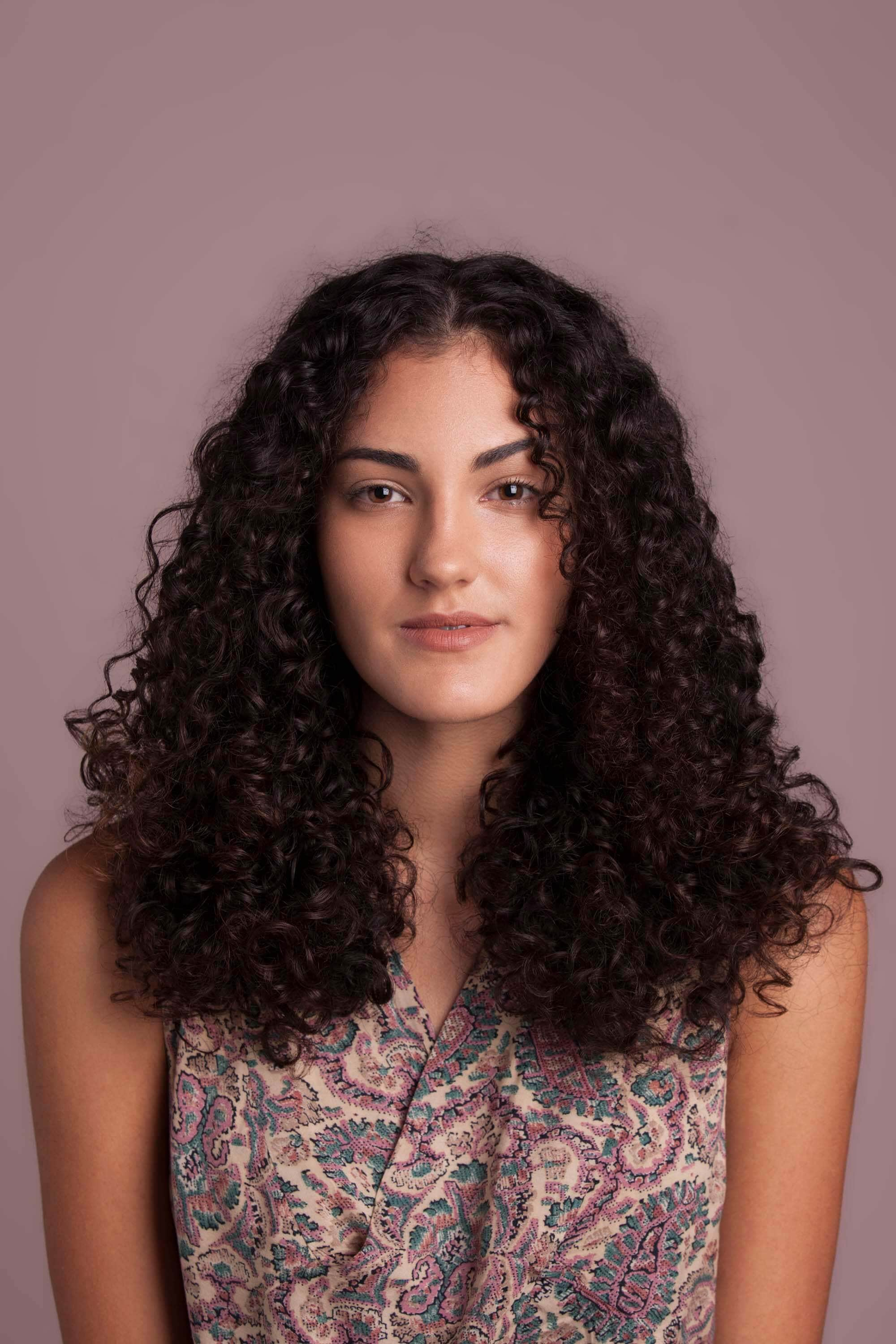 Brunette woman with blow dried curly hair