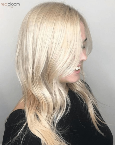 side view of a woman's hair with golden platinum blonde hair