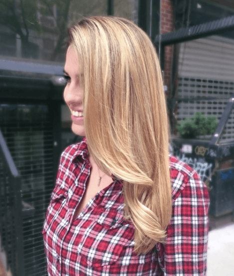side view of a woman with her long hair worn down in a natural blonde colour