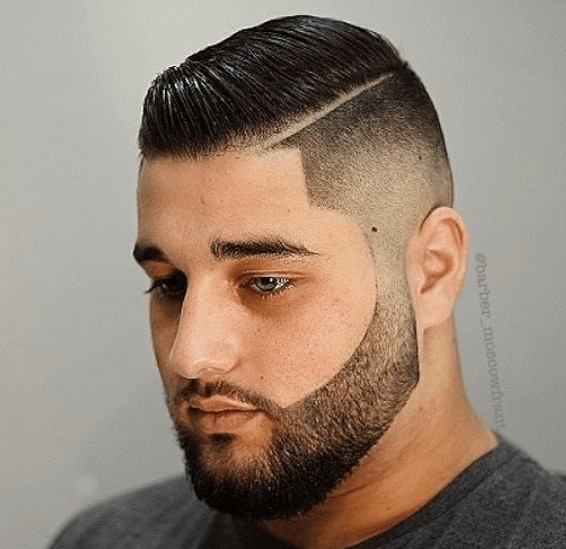 man with black hair in a short shaved sides and combed over style